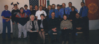 Fire Fighters with Beaver Township Trustee and Board Members with Senator Sue Landske in the old fire station.  2000
