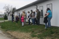 Community Members watch as StatFlight (out of Lafayette)  land behind the Mount Ayr Community Center during our first fire prevention breakfast and safety day in Mount Ayr.